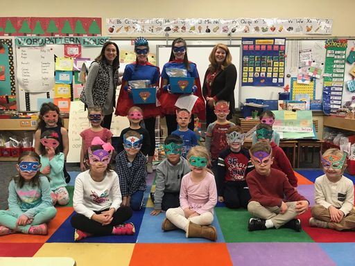 Kindergartners get surprise visit from Reading Super Heroes
