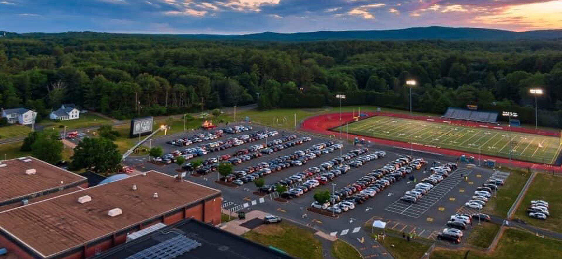 Aerial view of athletic field and parking lot
