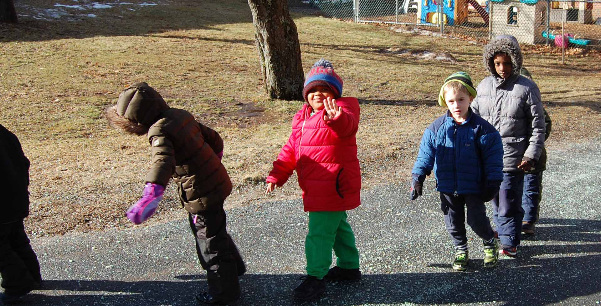 Group of students dressed for winter go to playground