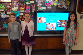 Third graders in from of a TV screen with their project